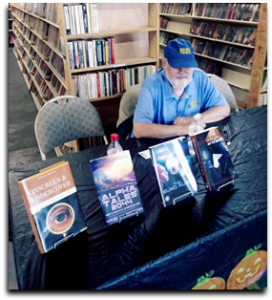 Wes Britton signs books